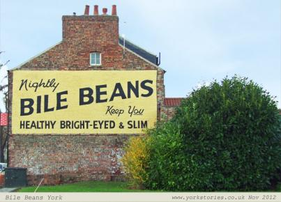 Newly repainted ghost sign on gable end wall
