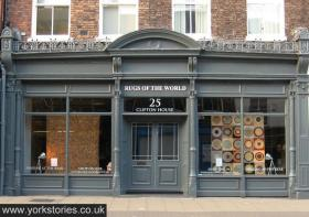 Remodelled storefront with central doorway and grey paintwork