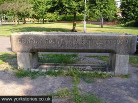 Low cattle trough bearing inscription 'Metropolitan Drinking Fountain and Cattle Trough Association'
