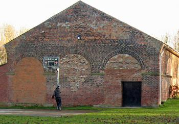 Brick building with bricked-up arched openings