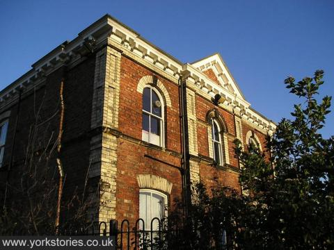 Victorian hospital building, red brick with white brick detail