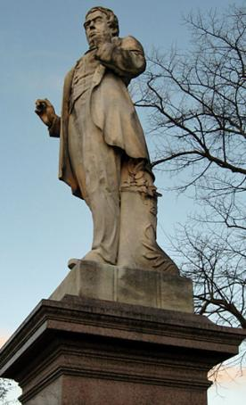 Statue on plinth, male figure, the usual