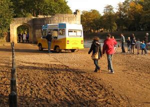 Ice cream van on muddy riverside paths