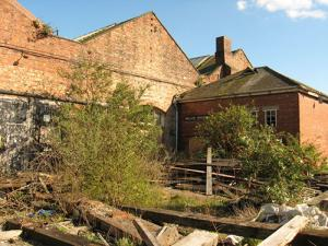 Workshops, debris, buddleia, litter