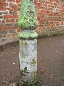 Old cast iron lamp post, with ornate detail on base