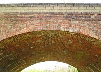Close-up of brickwork in arch of bridge