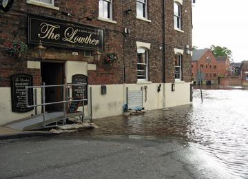 Pub next to flooded river