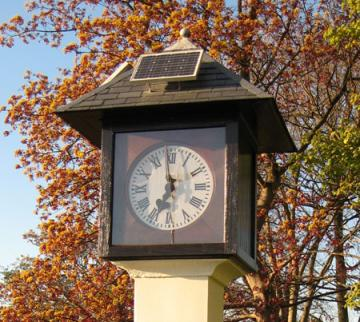 Early 20th century factory clock, 21st century solar panel fitted