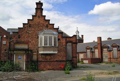 Once attractive primary school, red brick and stone, boarded up and looking derelict