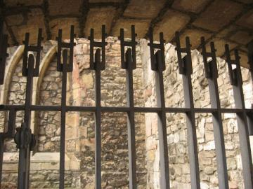 Detail of modern iron gate, closed, with open space visible behind