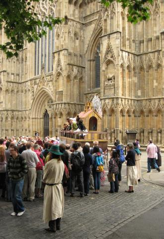 Pageant waggon, York Minster in background, crowds in foreground