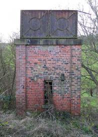 View of iron tank on brick support
