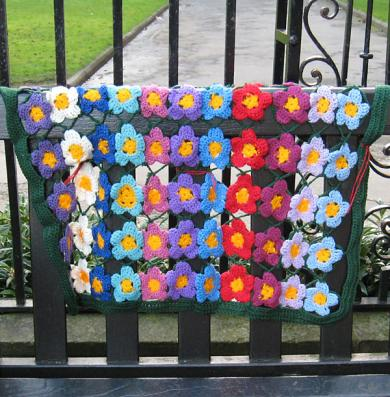 Crocheted flower panel, decorating a public bench