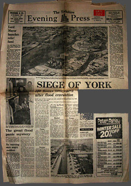 Paper has dramatic headline SIEGE OF YORK, large aerial view of floods, stories about the flood