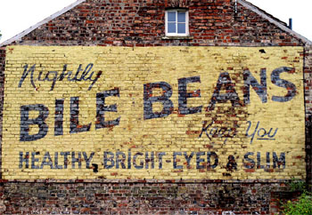Painted ad, 'ghost sign', on brick wall