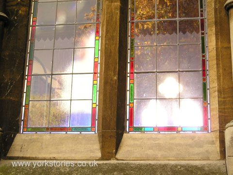 Light on stained glass window and stone surround