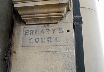 Gateway to passage, with Breary's Court painted on stone