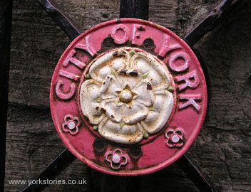 Painted iron roundel on city walls gates