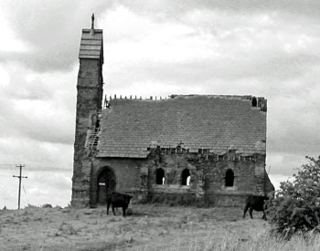 Ruined church, in field