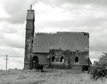 Ruined church, in field