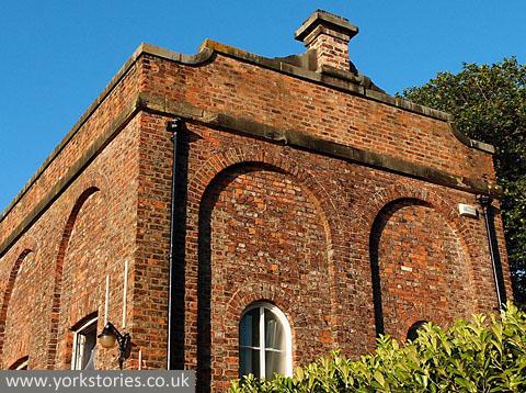 19th century red brick building