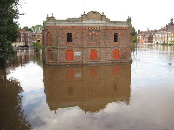Victorian riverside warehouse surrounded by floodwater