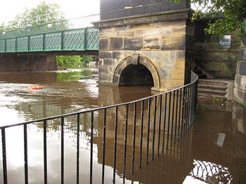 Flood waters under bridge