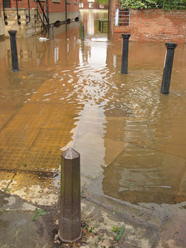 Flood water with paving visible through it