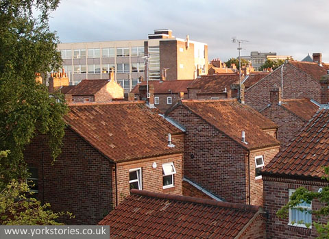 View over rooftops, and 1960s office block