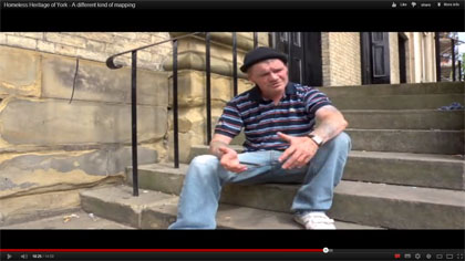 Man sitting on steps of Methodist chapel, York
