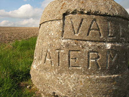 Concrete with inscription, alongside field