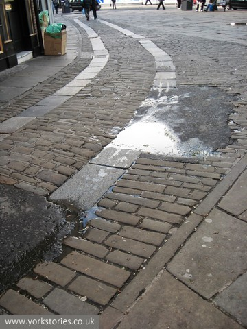 Paving, with tarmac patching