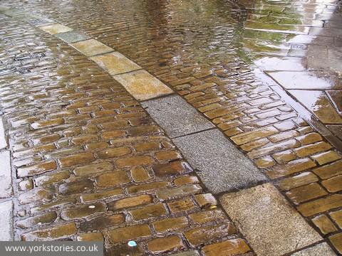 Paving, wet with rain