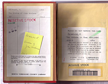 Inside front cover of library book, with old-fashioned labels and paper wallet holding yellow record card