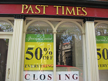 Shop window with sale and closing down signs