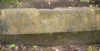 Sign reads 'Please do not climb on the banks'
