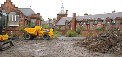 Victorian red brick school building, playground dug up