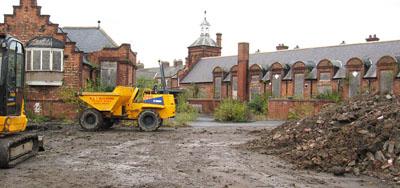 Victorian red brick school building, playground dug up