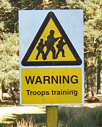 Reads 'Warning, troops training'
