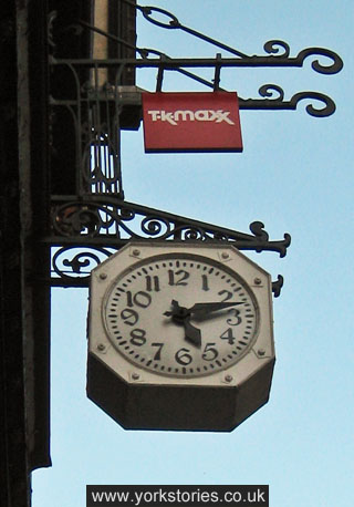 Street clock on ornate bracket