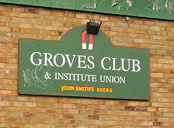Wooden sign: Groves Club and Institute Union. John Smith's Beers.