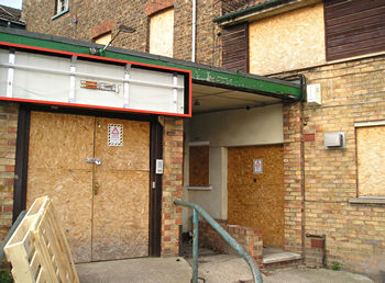 Boarded-up main entrance, Groves WMC