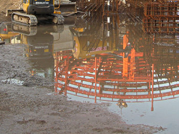 Reflections – West Offices work, in a building site puddle