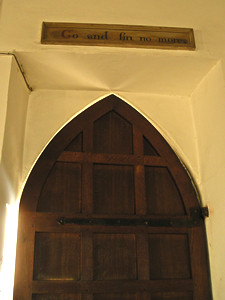 Church door sign – 'Go and sin no more'