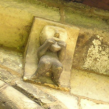 Grotesque on wall of St Mary, Kirkburn