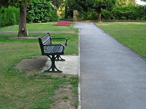View of West Bank Park – bench, paths and bedding plants