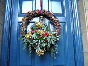 Festive wreath on a handsome blue-painted front door