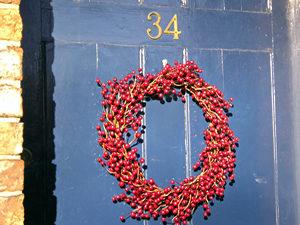 Festive wreath – red berries on blue door