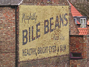 Painted ad on gable end, advertising Bile Beans