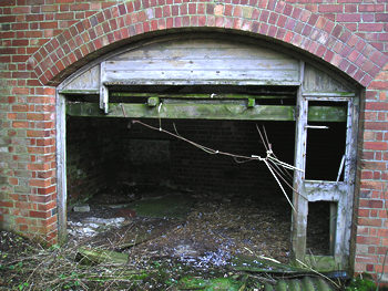 Remains of works – arch and broken door